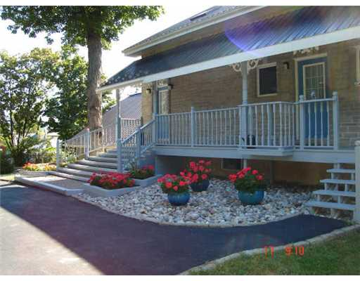 14225 Rd 38 - Stone Home on Large Lot with Lake Views!